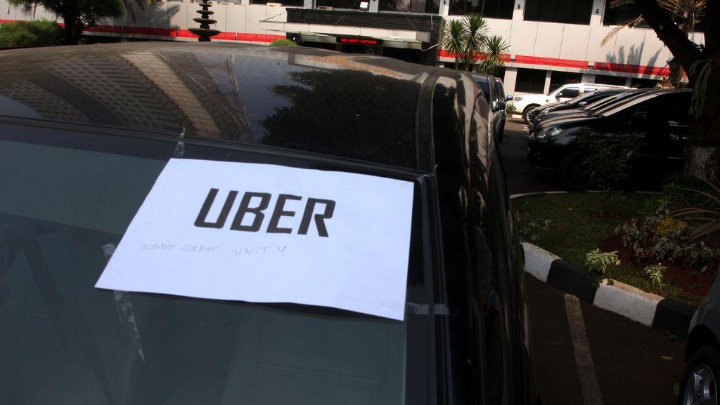Ditangkap Polisi, Driver Uber dan Grab Car Shock