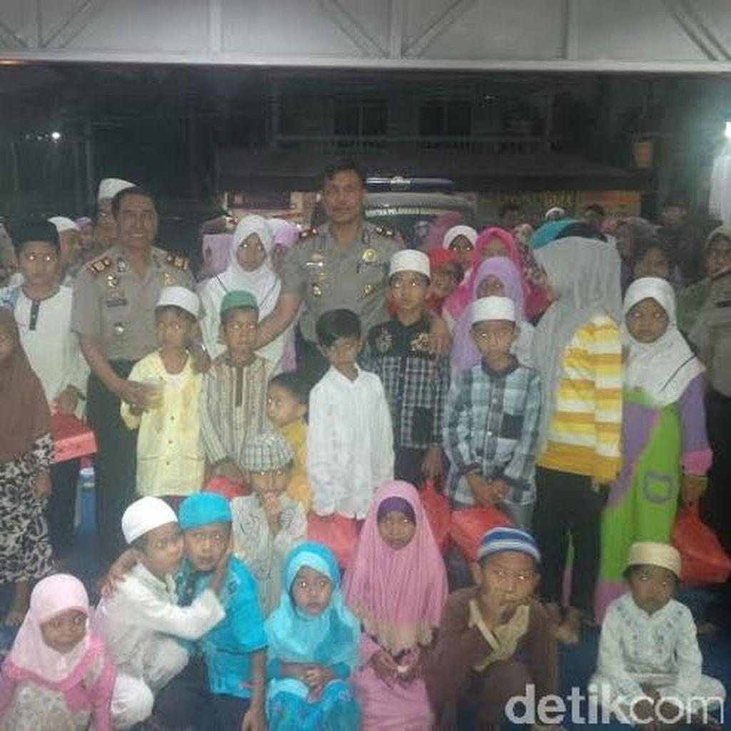 Blusukan ke Pemukiman Padat di Pulogebang, Polsek Cakung Santuni Anak Yatim