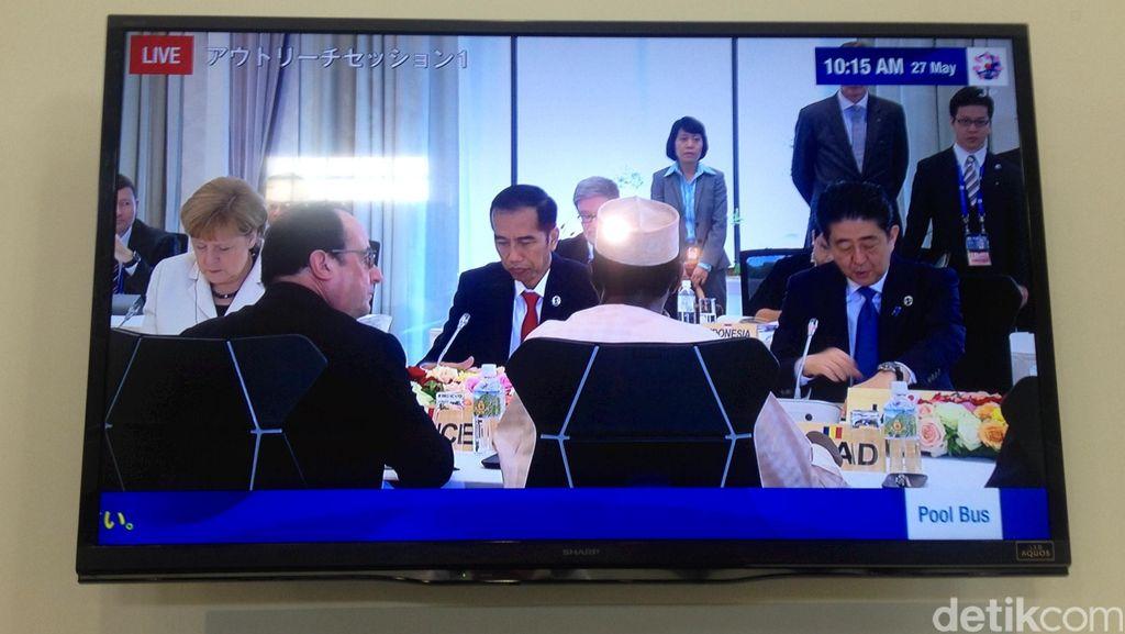 Saat Jokowi Diapit PM Abe dan Kanselir Merkel di Jepang