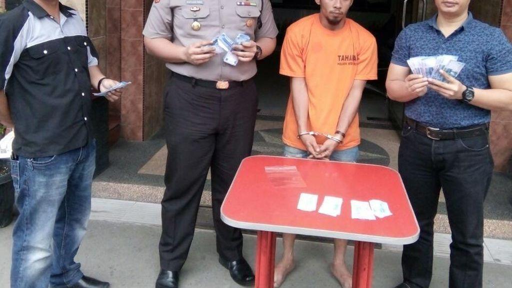 Polisi Bekuk Pecatan TNI yang Edarkan Uang Palsu di Medan