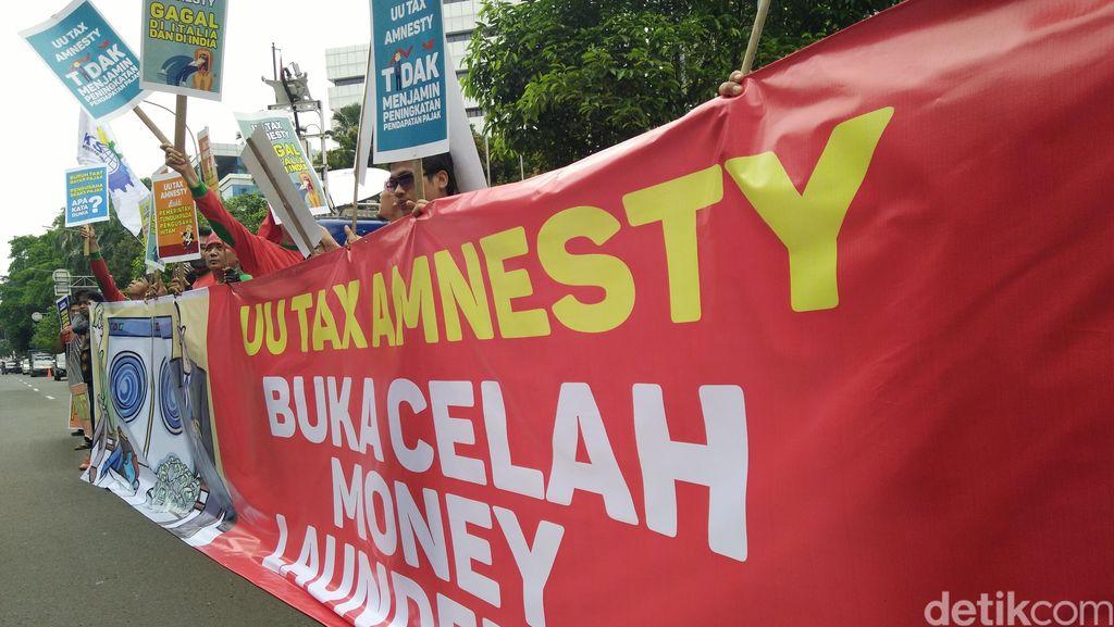 Buruh Demo MK Minta UU Tax Amnsety Dihapus