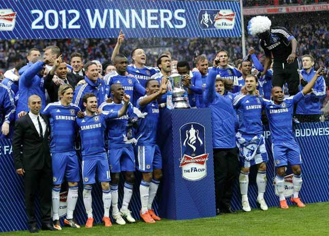 Para pemain Chelsea merayakan kemenangan. Reuters/Eddie Keogh.