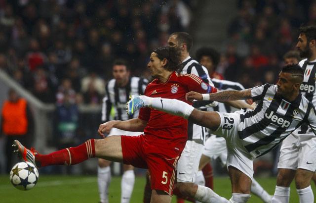 Tampil relatif dominan, Bayern menutup laga tersebut dengan skor 2-0. REUTERS/Michaela Rehle.