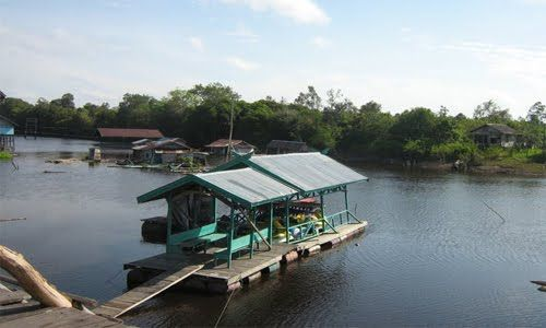 A floating house (with bridge) in Borneo
