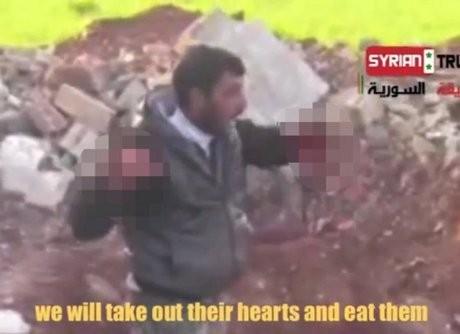 Mengerikan! Beredar Video Pemberontak Makan Jantung Tentara Suriah