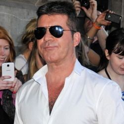 Simon Cowell Tegaskan Dirinya Bukan Gay