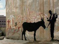 Dilelang Rp 13,5 M, Grafiti Banksy di Bethlehem Jadi Kontroversi