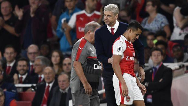 Arsene Wenger dihadapkan pada transfer pemain kelas dunia lain menjelang kepindahan Alexis Sanchez ke MU.