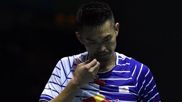 Lin Dan tak mampu melewati adangan Jonatan Christie pada babak pertama China Open 2017.