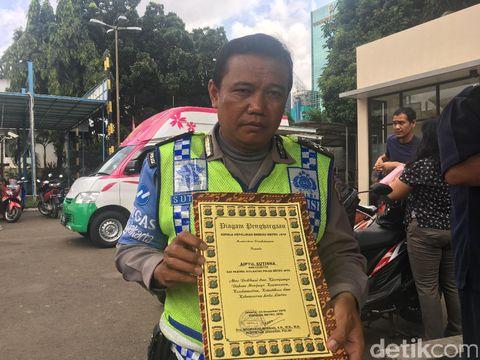 Anggota Satuan Patwal Ditlantas Polda Metro Jaya Aiptu Sutisna korban amukan Dora