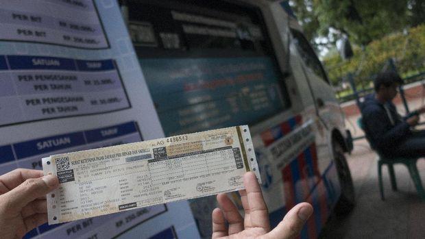 Pengemudi taksi online nantinya juga harus punya STNK berbadan hukum.