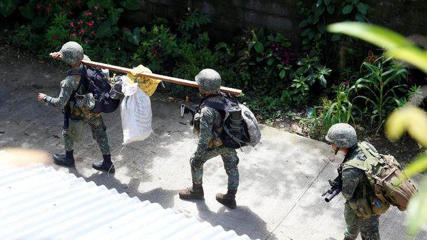 Bentrokan antara militer Filipina dan militan Maute yang berafiliasi dengan ISIS telah berlangsung selama sepekan dan menewaskan lebih dari 100 orang, termasuk warga sipil.