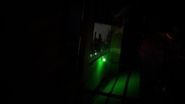 Warung-warung dengan lampu temaram berdiri di bawah tol di Kalijodo.