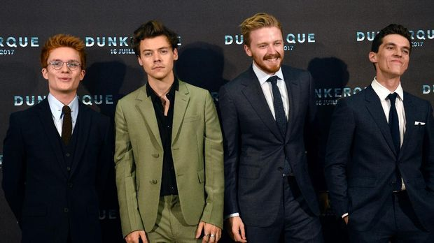 (From L) British actor Tom Glynn-Carney, British singer, songwriter and actor Harry Styles, British actor Jack Lowden and British actor Fionn Whitehead pose on July 16, 2017, during a photo-call at the cinema Ocine in Dunkirk, for the premier of the movie