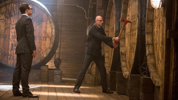 Mark Strong sebagai Merlin di Kingsman.