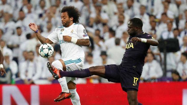 Tottenham Hotspurs membangun pertahanan yang amat solid untuk membendung serangan-serangan Madrid. (
