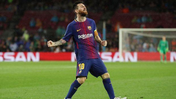 Lionel Messi mencetak dua gol ketika Barcelona mengalahkan Olympiakos 3-1.
