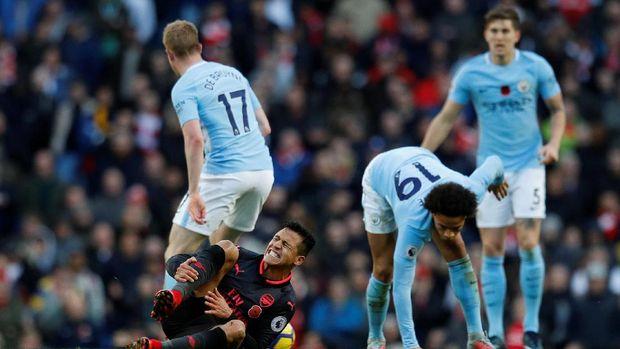 Alexis Sanchez tak sanggup membawa Arsenal meraih poin di markas Manchester City.