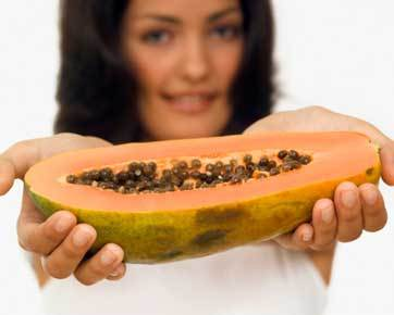 lady holding papaya
