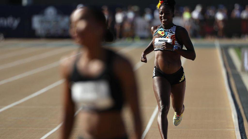 Foto: Tangguhnya Pelari Ini, Tetap Berlomba Meski Hamil 5 Bulan